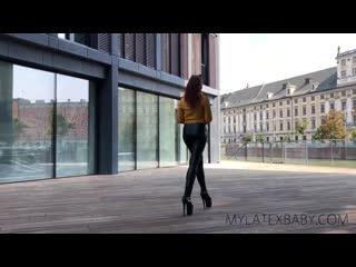 Latex Fox walks around Wroclaw in leather leggings