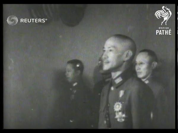 CHINA General Stilwell decorates General Chiang Kai Shek Madame Chiang Kai Shek talks 1943