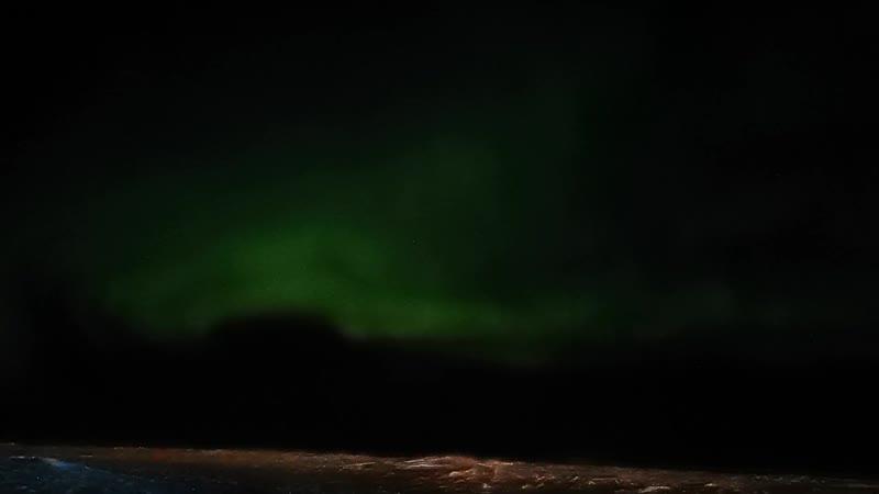 Северное сияние над Баренцевым морем в Ненецком автономном округе