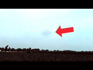Huge UFO caught on camera while Indonesian farmers work! Must Watch