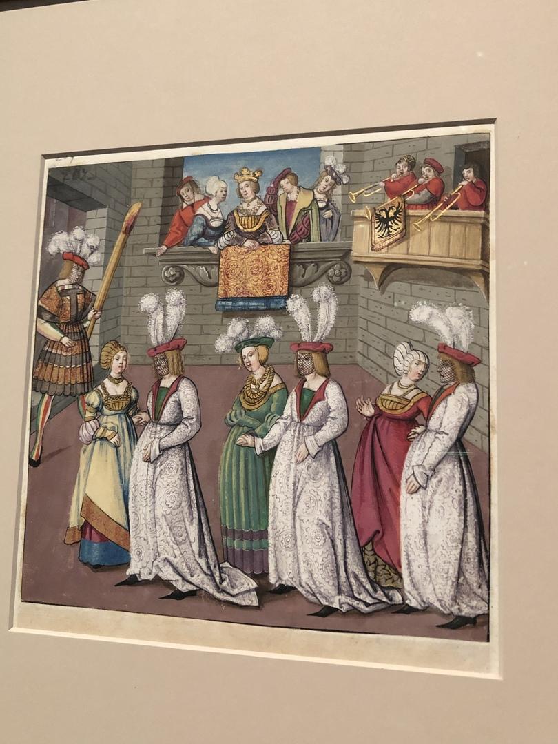 Маскарад с мужчинами в женской одежде и сетками на лицах